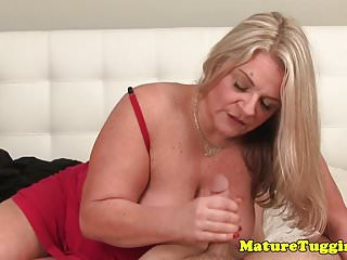 Busty MILF handjob mom milking shaft point of view