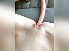 She masturbates with a huge cock and makes herself squirt