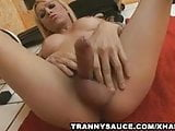 Sexy blonde shemale strokes on the floor