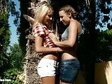 Seduced Gardener featuring Lena and Morgan splash each other