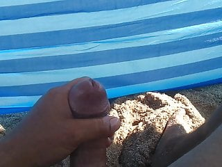 Big cock handjob on the beach