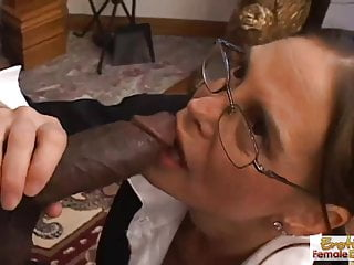 Sexy milf in glasses deepthroats an enormous...