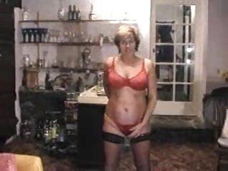 Mature lady strips