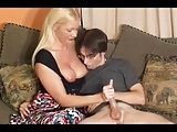 Busty Mature Give Handjob To Nerdy Boy.