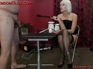 Blonde brutal femdom punishes male slave...