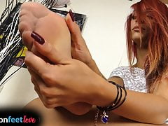 Tattooed redhead shows feet in pantyhose and stockings