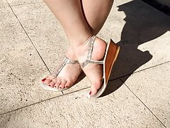 Super sexy long red toenails and glamorous thong sandals