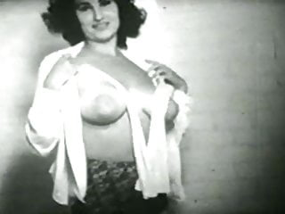 Vintage girl with big tits teases before bathtime