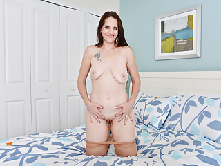 American milf Christina Sapphire rubs her vagina furiously