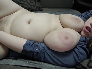 Chubby brunette gently jerks off her pussy