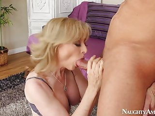 Naughty America Nina Hartley fucking in the living room with