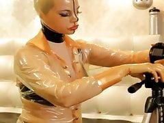 WOMAN PUTS ON LATEX CONDOM SUIT