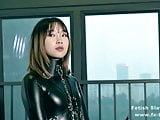 Bondage leather catsuit girl single gloves