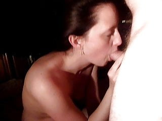 Naked being filmed giving a cock sucking and swallowing cum