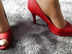 wife modelling in red peep toe heels of another woman