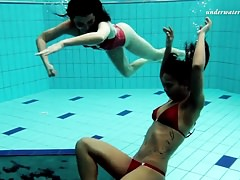 Lesbian fun underwater and naked stripping