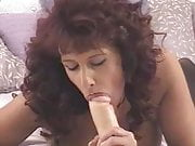 Mature redhead sucking a dildo