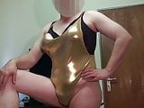 Fake Boobs - some posing in shiny gold swimsuit, shaved body