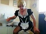 sissy ken in maids uniform rides dildo around the house