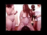 Two women help another get off on the Sybian