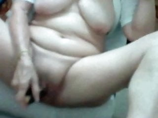 Fucks her pussy with hairbrush...