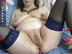 A mature bitch caresses her working hole