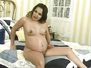 Plump and juicy pregnant slut shows her titts and wide open pussy