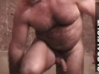 Hairy older bodybuilder muscledaddy showering gym lockerroom...
