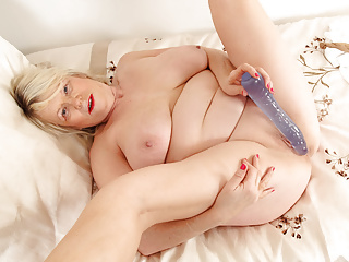 The Adult Video Experience –  Busty grandma Elle gets naughty in nylons