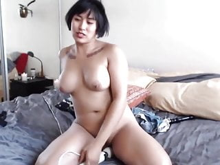 Asian chick fingers pussy and rides vibrator...