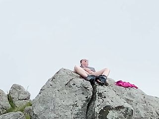 Zoey masturbating in public high up on a rock in the harbor