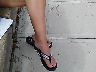 Pretty blonde college student dangling her feet