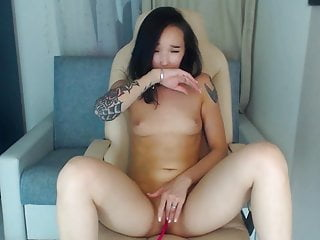 Hot asian cam magnificence spanks and cums tenderly
