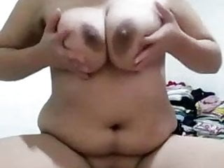 Phillipino chubby with great tits rubbing her cunt