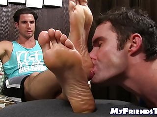 Handsome dude orders his buddy to suck on his toes and feet