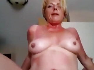 riding amateur smiles granny cock while