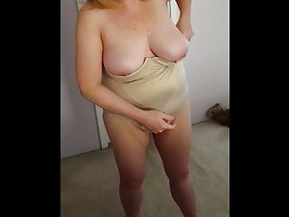 putting on her girdle over big tits n belly