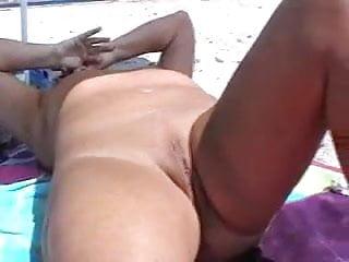 Mature masturbating naked beach...